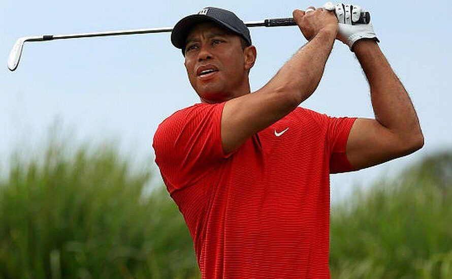 Golf players sported red and black-out of appreciation for Tiger Woods during Sunday's play